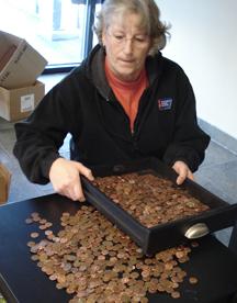 Theresa Ambs counts pennies forACS.
